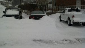 That's my poor car buried under all of that snow.